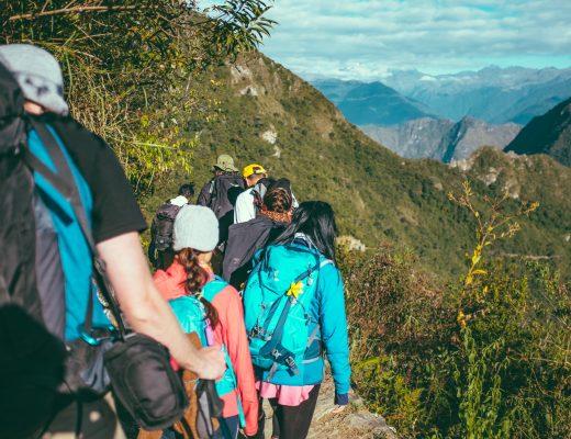people walking beside the mountain