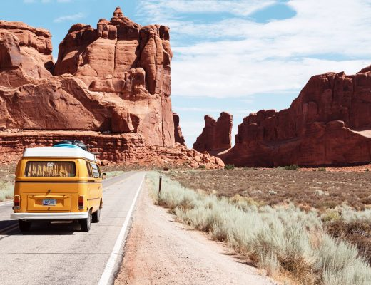 yellow Volkswagen van on road
